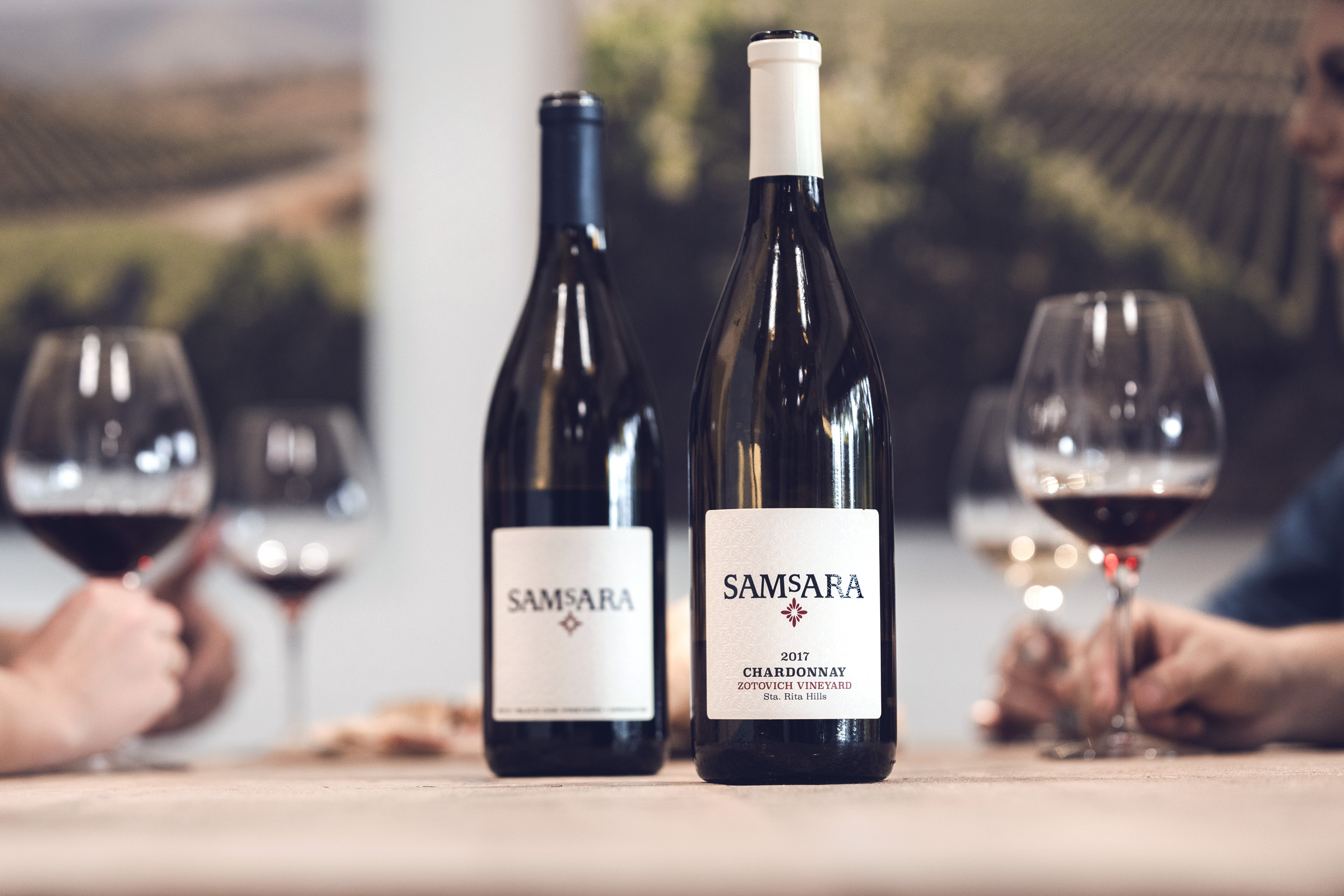 two bottles of SAMsARA wine in Goleta tasting room table
